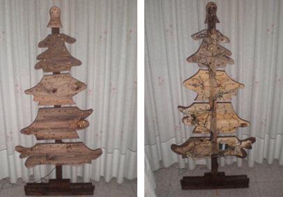 Arbol de Navidad creado con tablas y luces navideñas